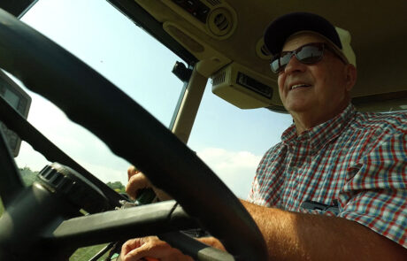 Man driving across conservation land